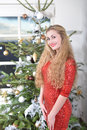 December girl standing beside the christmas tree Stock Photo