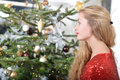 December girl standing beside the christmas tree Royalty Free Stock Photography