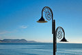 December morning lyme regis nautilus lamp at the seafront on a crisp winter with the jurassic coastline in the background Royalty Free Stock Photography