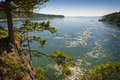 Deception pass state park washington rugged cliffs drop to meet the turbulent waters of the is known for its breath taking views Stock Photos