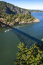Deception pass state park washington rugged cliffs drop to meet the turbulent waters of the is known for its breath taking views Royalty Free Stock Images