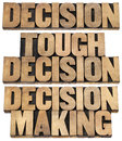 Decision cocnept in wood type tough and making collage of isolated text letterpress printing blocks Royalty Free Stock Photos