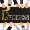 Decision photo of business hands holding blackboard and writing concept Royalty Free Stock Image