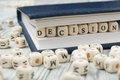 Decision word formed by wood alphabet blocks