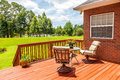 Deck backyard overlooking lake outside residential structure Royalty Free Stock Photo