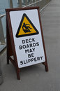 Deck boards may be slippery sign Royalty Free Stock Photo