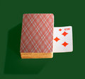 Deck of cards and one up card on green background Royalty Free Stock Photo