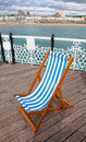 Deck chair pier sea coastline Stock Photos