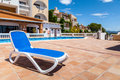 Deck chair in a swimming pool from rural village mallorca spain Stock Photos