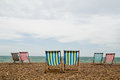 Deck chairs on brighton beach england stripy a shingle in southwest taken an overcast day Stock Images