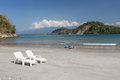 Deck chairs on the carribean beach in costa rica a view of tropical Royalty Free Stock Image