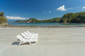 Deck chairs on the carribean beach in costa rica a view of tropical Stock Photo