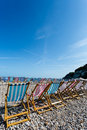 Deck chairs lined up on a beach Stock Image