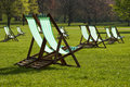 Deck chairs in a park Royalty Free Stock Photo