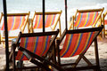 Deck chairs on Pattaya beach . Royalty Free Stock Photo