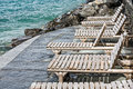 Deck chairs on the shores of lake geneva wooden shore by in montreux Royalty Free Stock Photography