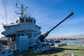 Deck gun navy ship minesweeper monument rusting away a twenty mm oerlikon on of a coastal rotting away in corner of harbor with Royalty Free Stock Photos