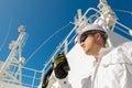 Deck officer speaking by vhf on deck radar under blue sky Royalty Free Stock Image