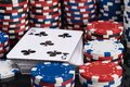 Deck of playing cards surrounded by stacks of poker chips background Royalty Free Stock Photo
