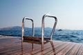 Deck and sea ladder of a sailing yacht to the Stock Photography