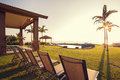 Deck with sunset view beautiful home exterior patio and lounge chairs on lawn Royalty Free Stock Photography
