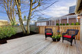 Deck with two chairs and fenced yard home exterior Royalty Free Stock Photos