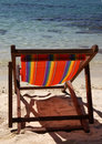 Deckchair on the sunny beach Royalty Free Stock Photos