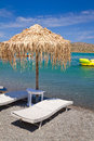 Deckchair under parasol at Aegean Sea Royalty Free Stock Photography