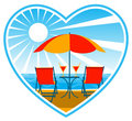 Deckchairs on beach in heart Royalty Free Stock Photography