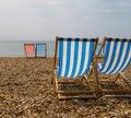 Deckchairs on Brighton Beach. Royalty Free Stock Photo
