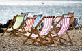 Deckchairs on Brighton beach Royalty Free Stock Photos