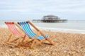 Deckchairs on Brighton beach. Brighton, England Royalty Free Stock Photo
