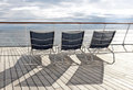 Deckchairs empty on deck of cruise ship Royalty Free Stock Photo