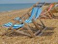 Deckchairs lined up on beach. Stock Photography