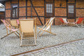Deckchairs on street untypical garden café in the jewish district of krakow in museum of urban engineering in kazimierz poland Stock Photos