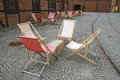 Deckchairs on street untypical garden café in the jewish district of krakow in museum of urban engineering in kazimierz poland Royalty Free Stock Image