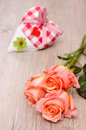 Declaration of love with orange roses and heart cloth Royalty Free Stock Photo