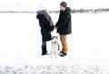 Declaration of love on snow and Siberian huskies