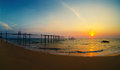 Decline on the seashore destroyed pier Royalty Free Stock Image