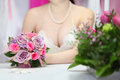 Decollete of young bride, which sits at table Royalty Free Stock Photo