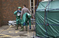 Decontamination tent and men removing their protective clothing Royalty Free Stock Photo