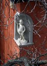 Decor element in the form of a boy at the corner of the house Royalty Free Stock Photo