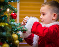 Decorate adorable year old boy christmas tree Stock Image