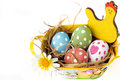 Decorated basket full of colorful eggs five in a with straw petals and flowers the field Royalty Free Stock Photography
