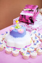 Decorated birthday cake cupcakes little girl Stock Image