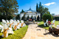 Decorated chairs on a outdoor wedding garden party Stock Photography