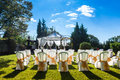 Decorated chairs on a outdoor wedding garden party Royalty Free Stock Image