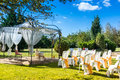 Decorated chairs on a outdoor wedding garden party Stock Images
