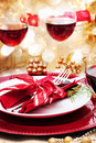 Decorated christmas dinner table with red wine Stock Photo
