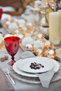 Decorated Christmas holiday table ready for dinner. Beautifully   set with candles, spruce twigs, plates and serviettes Royalty Free Stock Photo